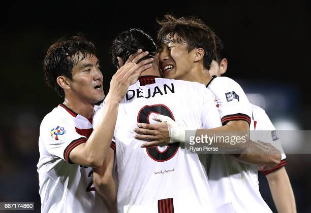 Dejan Damjanovic of FC Seoul is congratulated by Hwang KiWook and Lee SeokHyun of FC Seoul after scoring his teams third goal during the AFC...