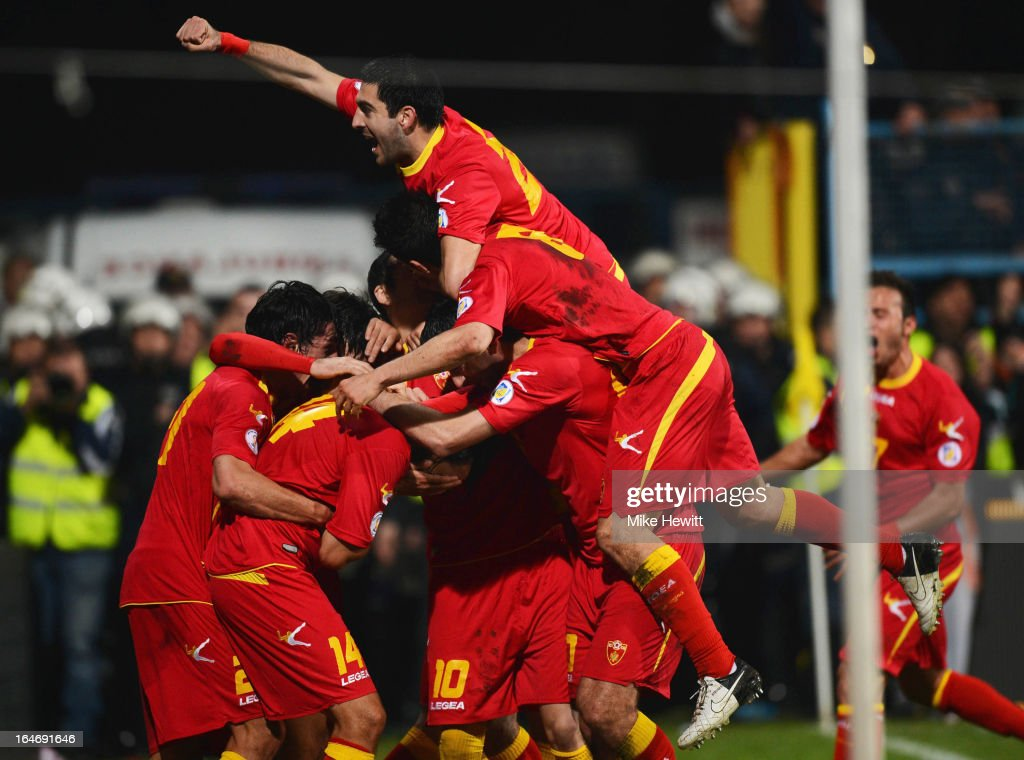Dejan Damjanovic of Montenegro (14) is congratulated by team-mates as he scores their first goal during the FIFA 2014 World Cup Qualifier Group H match between Montenegro and England at City Stadium on March 26, 2013 in Podgorica, Montenegro.