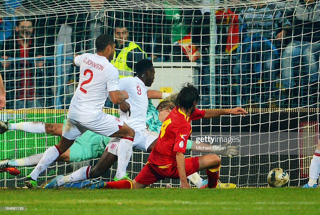 Dejan Damjanovic of Montenegro scores the equalising goal during the FIFA 2014 World Cup Qualifier Group H match between Montenegro and England at City Stadium on March 26, 2013 in Podgorica, Montenegro.