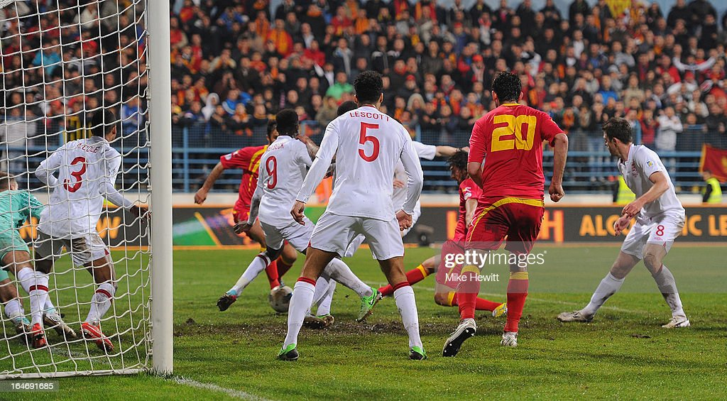 Dejan Damjanovic of Montenegro scores their first goal during the FIFA 2014 World Cup Group H Qualifier between Montenegro and England at City Stadium on March 26, 2013 in Podgorica, Montenegro.