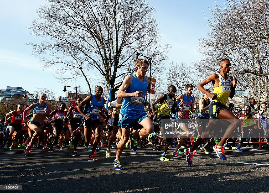 Dejan Gebremeskel of Ethopia leads a pack of runners near the start of the 2014 B.A.A. 5K on April 19, 2014 in Boston, Massachusetts. Gebremeskel finished in first place and set a course record.