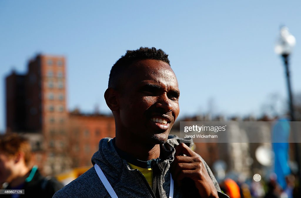 Dejan Gebremeskel of Ethopia waits to accept his award after finishing first in the 2014 B.A.A. 5K on April 19, 2014 in Boston, Massachusetts.