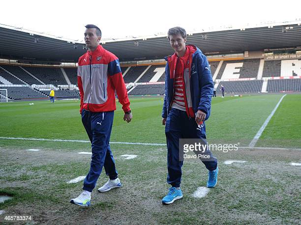 Dejan Iliev and Krystian Bielik of Arsenal walk out to look at the pitch before the match between Derby County U21 and Arsenal U21 at iPro Stadium on...