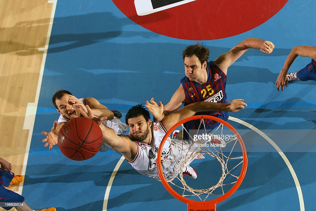 Dejan Ivanov, #44 of Lietuvos Rytas Vilnius competes with Erazem Lorbek, #25 of FC Barcelona Regal during the 2012-2013 Turkish Airlines Euroleague Regular Season Game Day 7 between FC Barcelona Regal v Lietuvos Rytas Vilnius at Palau Blaugrana on November 22, 2012 in Barcelona, Spain.