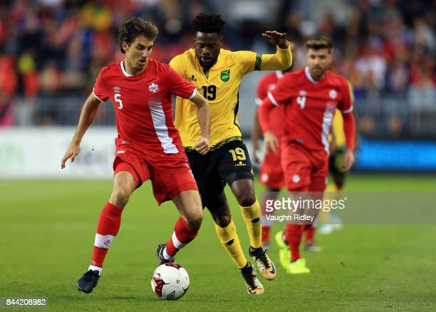 Dejan Jakovic of Canada battles for the ball with Ricardo Morris of Jamaica during an International Friendly match at BMO Field on September 2 2017...