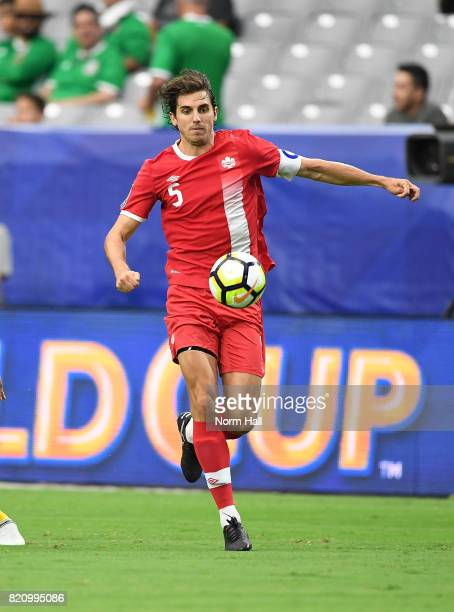Dejan Jakovic of Canada controls the ball against Jamaica in a quarterfinal match during the CONCACAF Gold Cup at University of Phoenix Stadium on...