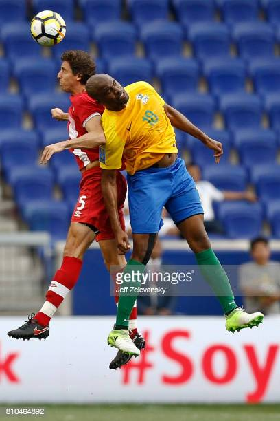Dejan Jakovic of Canada fights for the ball with Loic Baal of French Guiana during their Concacaf Gold Cup match at Red Bull Arena on July 7 2017 in...