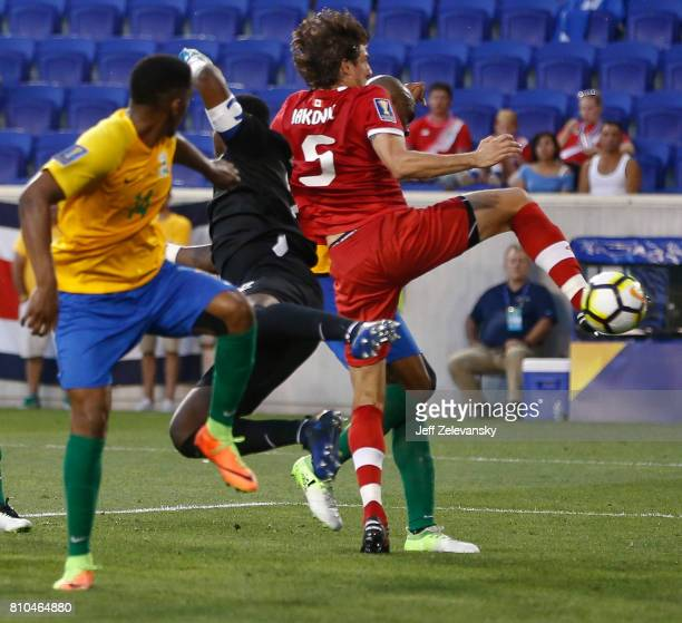 Dejan Jakovic of Canada scores on Donovan Leon of French Guiana during their Concacaf Gold Cup match at Red Bull Arena on July 7 2017 in Harrison New...