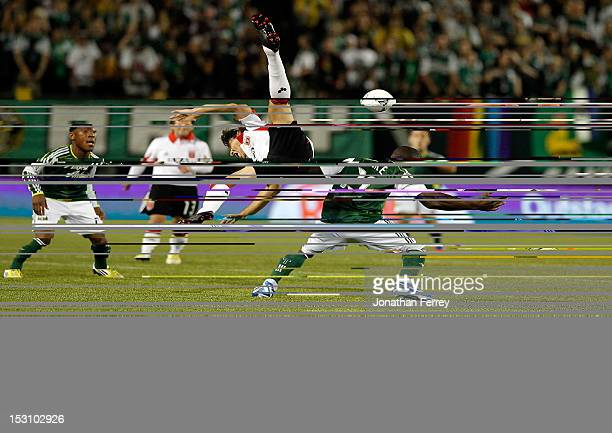 Dejan Jakovic of DC United is upended by Bright Dike of the Portland Timbers on September 29 2012 at JeldWen Field in Portland Oregon