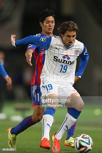 Dejan Jakovic of Shimizu SPulse and Yoshinori Muto of FC Tokyo compete for the ball during the JLeague Yamazaki Nabisco Cup Group A match between FC...