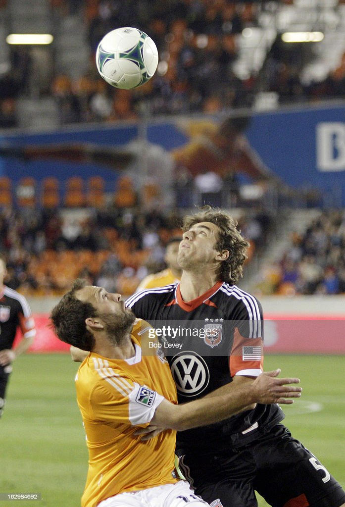Dejan Jakovic #5 of the D.C. United and Adam Moffat #16 of the Houston Dynamo battle for the ball during second half action at BBVA Compass Stadium on March 2, 2013 in Houston, Texas. Houston won 2-0.