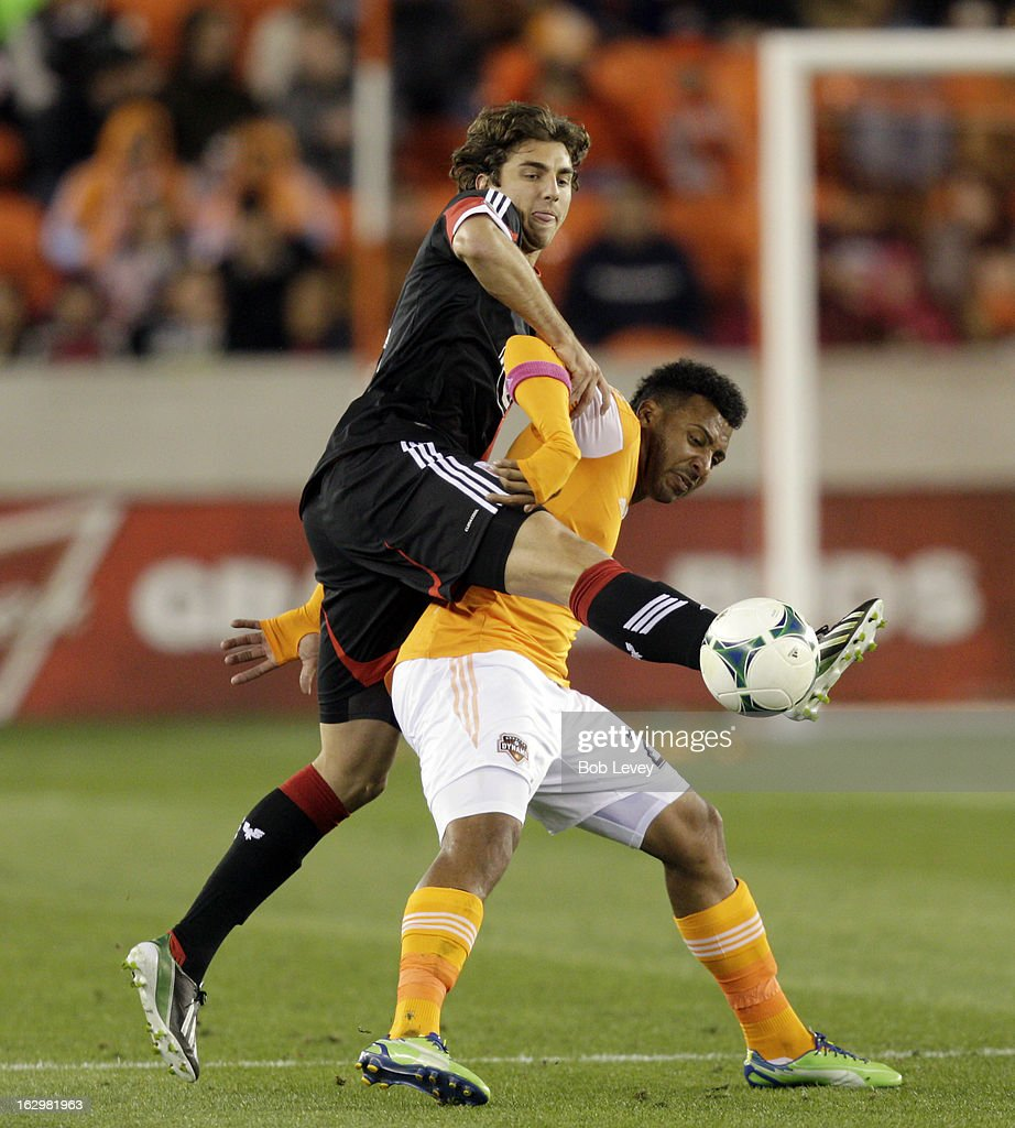 Dejan Jakovic #5 of the D.C. United goes over the back of Giles Barnes #23 of the Houston Dynamo during first half action at BBVA Compass Stadium on March 2, 2013 in Houston, Texas.
