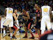 Dejan Kravic of the Texas Tech Red Raiders celebrates with teammates after scoring the final basket as the Red Raiders defeated the West Virginia...