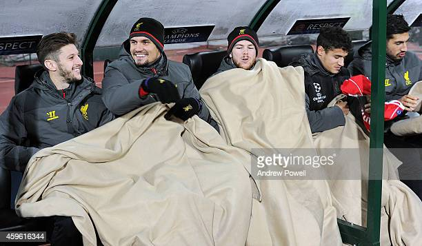 Dejan Lovren Adam Lallana Alberto Moreno Philippe Coutinho and Emre Can of Liverpool all try to stay warm during the UEFA Champions League match...