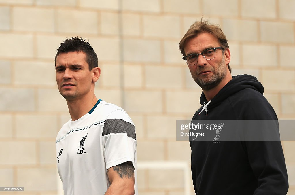 <a gi-track='captionPersonalityLinkClicked' href=/galleries/search?phrase=Dejan+Lovren&family=editorial&specificpeople=5577379 ng-click='$event.stopPropagation()'>Dejan Lovren</a> (L) and Jurgen Klopp, manager of Liverpool arrive for a press conference ahead of the UEFA Europa League Semi-Final Second Leg match against Villarreal at Melwood Training Ground on May 4, 2016 in Liverpool, England.