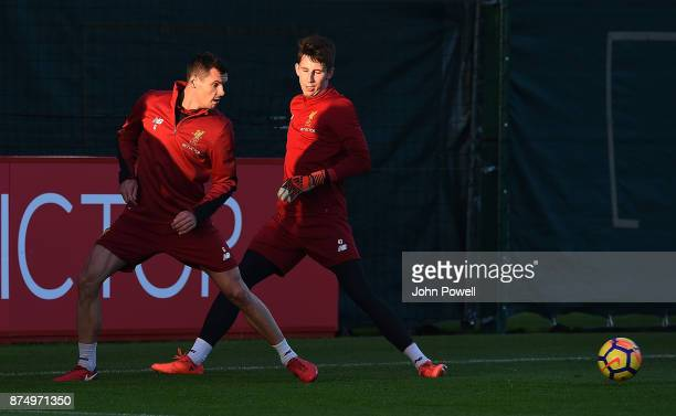 Dejan Lovren and Kamil Grabara of Liverpool during a training session at Melwood Training Ground on November 16 2017 in Liverpool England