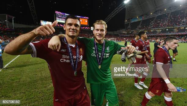 Dejan Lovren and Loris Karius of Liverpool at the end the Premier League Asia Trophy match between Liverpool FC and Leicester City FC at the Hong...