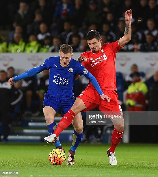 Dejan Lovren and Mamadou Sakho of Liverpool take on Jamie Vardy of Leicester City during the Barclays Premier League match between Leicester City and...