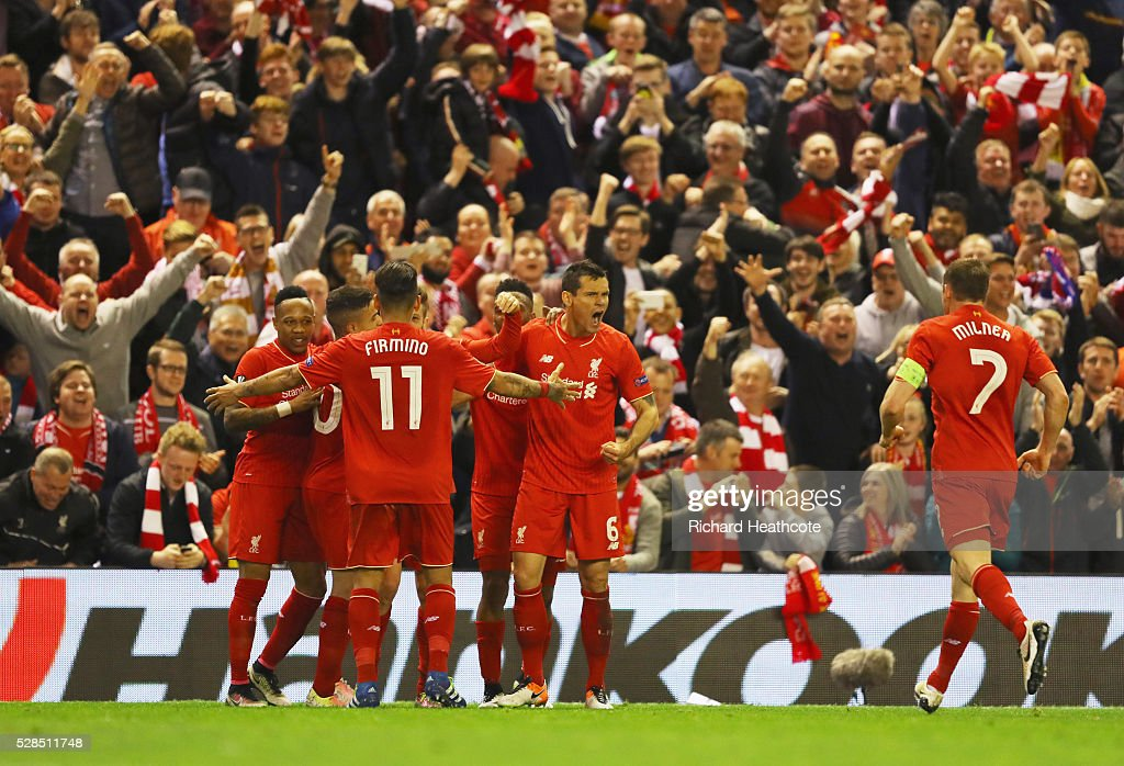 Dejan Lovren (6) celebrates with team mates and fans as Adam Lallana of Liverpool (obscured) scores their third goal during the UEFA Europa League semi final second leg match between Liverpool and Villarreal CF at Anfield on May 5, 2016 in Liverpool, England.