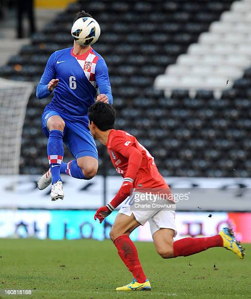 Dejan Lovren Croatia attacks the ball in the air during the International Friendly match between Croatia and Korea Republic at Craven Cottage on...