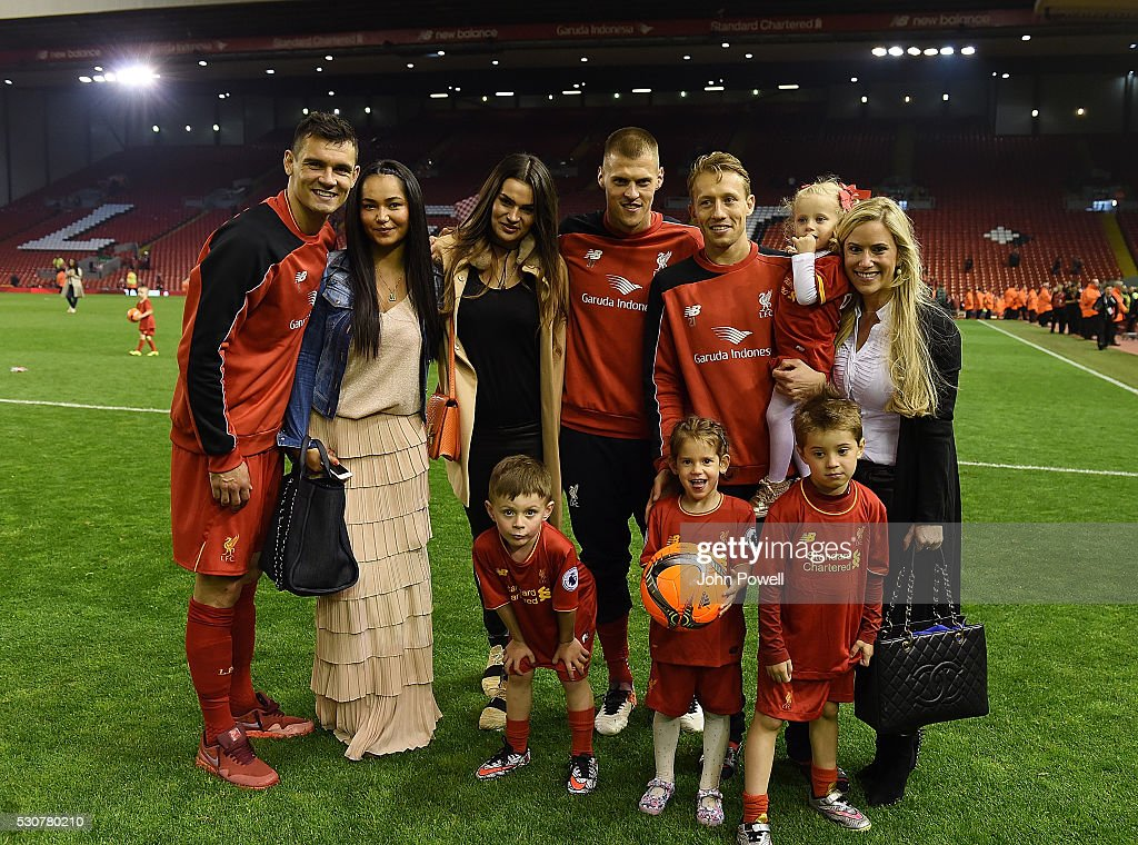 Dejan Lovren, Martin Skrtel and Lucas Leiva and their family at the end of the Barclays Premier League match between Liverpool and Chelsea at Anfield on May 11, 2016 in Liverpool, England.