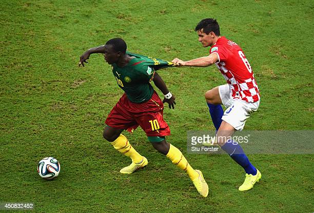 Dejan Lovren of Croatia challenges Vincent Aboubakar of Cameroon during the 2014 FIFA World Cup Brazil Group A match between Cameroon and Croatia at...
