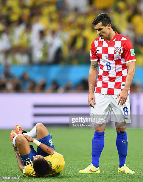 Dejan Lovren of Croatia looks to Neymar of Brazil during the 2014 FIFA World Cup Brazil Group A match between Brazil and Croatia at Arena de Sao...