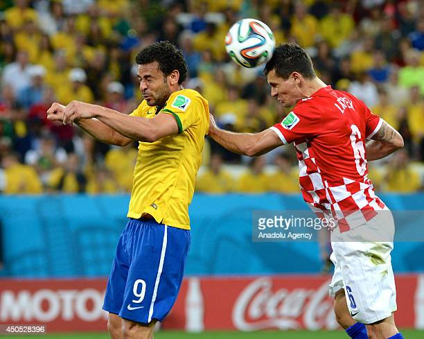 Dejan Lovren of Croatia struggles with his competitor Fred of Brazil during the 2014 FIFA World Cup Brazil Group A match between Brazil and Croatia...