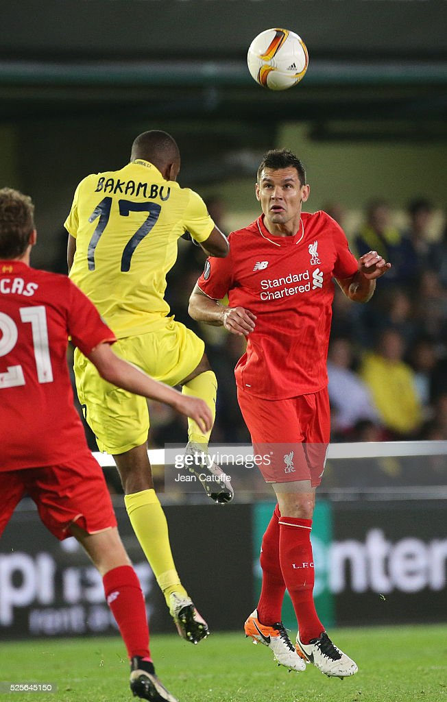 Dejan Lovren of Liverpool and Cedric Bakambu of Villarreal (left) in action during the UEFA Europa League semi final first leg match between Villarreal CF and Liverpool FC at Estadio El Madrigal stadium on April 28, 2016 in Villarreal, Spain.