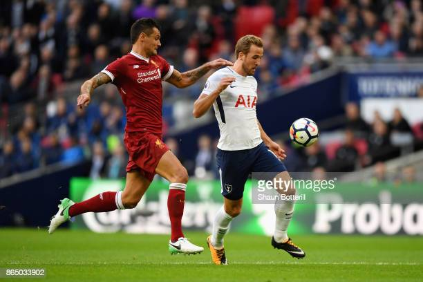 Dejan Lovren of Liverpool and Harry Kane of Tottenham Hotspur battle for possession during the Premier League match between Tottenham Hotspur and...