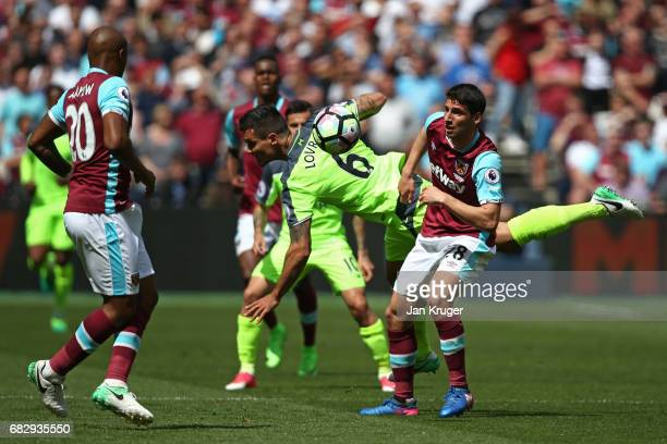 Dejan Lovren of Liverpool and Jonathan Calleri of West Ham United compete for the ball during the Premier League match between West Ham United and...
