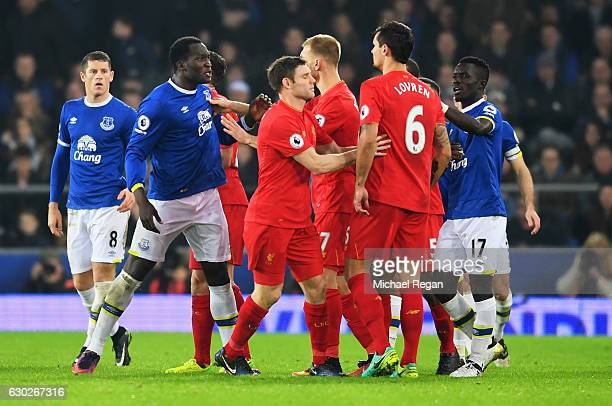 Dejan Lovren of Liverpool and Romelu Lukaku of Everton confront each other as players clash during the Premier League match between Everton and...
