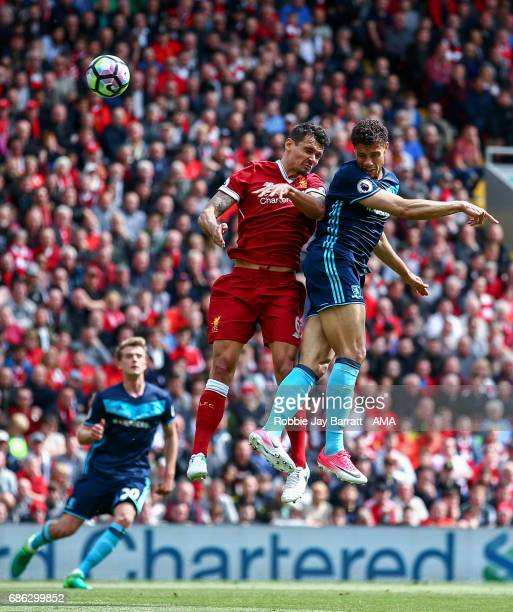 Dejan Lovren of Liverpool and Rudy Gestede of Middlesbrough during the Premier League match between Liverpool and Middlesbrough at Anfield on May 21...