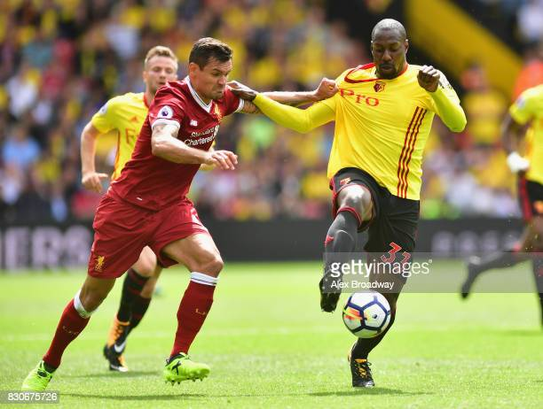 Dejan Lovren of Liverpool and Stefano Okaka of Watford battle for possession during the Premier League match between Watford and Liverpool at...