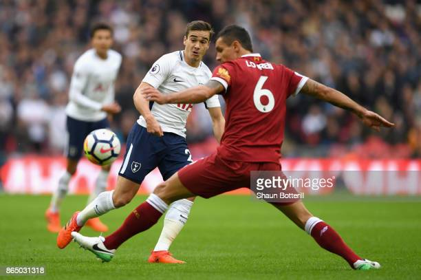 Dejan Lovren of Liverpool attempts to stop a pass from Harry Winks of Tottenham Hotspur during the Premier League match between Tottenham Hotspur and...