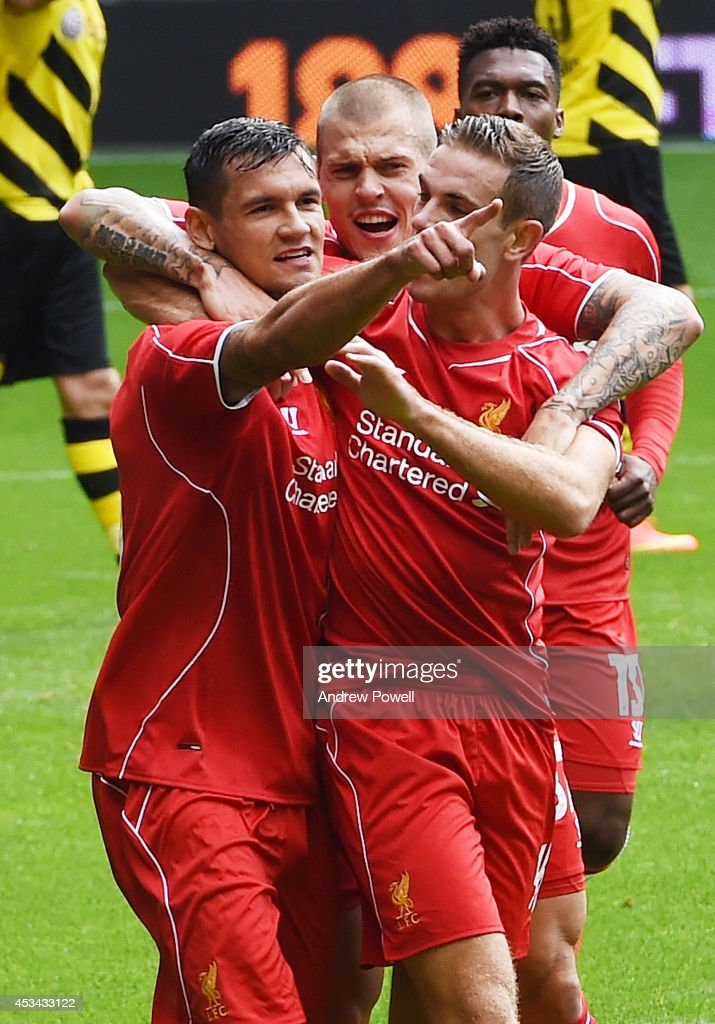 <a gi-track='captionPersonalityLinkClicked' href=/galleries/search?phrase=Dejan+Lovren&family=editorial&specificpeople=5577379 ng-click='$event.stopPropagation()'>Dejan Lovren</a> of Liverpool celebrates his goal with <a gi-track='captionPersonalityLinkClicked' href=/galleries/search?phrase=Jordan+Henderson&family=editorial&specificpeople=4940390 ng-click='$event.stopPropagation()'>Jordan Henderson</a> and <a gi-track='captionPersonalityLinkClicked' href=/galleries/search?phrase=Martin+Skrtel&family=editorial&specificpeople=5554576 ng-click='$event.stopPropagation()'>Martin Skrtel</a> during Pre Season Friendly match between Liverpool and Borussia Dortmund at Anfield on August 10, 2014 in Liverpool, England.