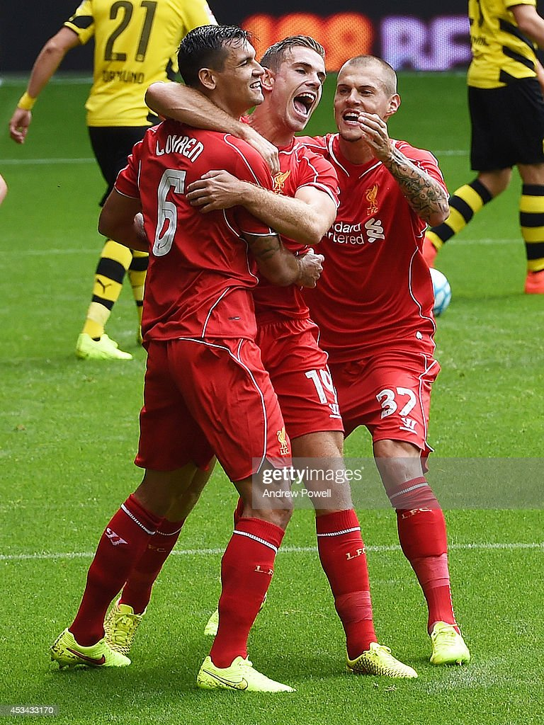 Dejan Lovren of Liverpool celebrates his goal with Jordan Henderson and Martin Skrtel during Pre Season Friendly match between Liverpool and Borussia Dortmund at Anfield on August 10, 2014 in Liverpool, England.