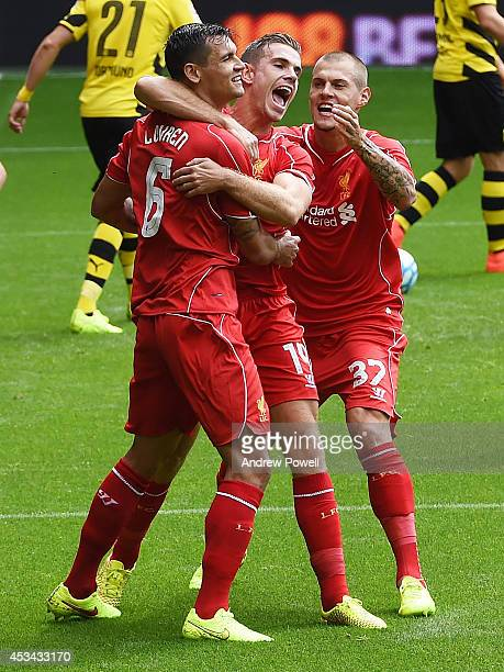 Dejan Lovren of Liverpool celebrates his goal with Jordan Henderson and Martin Skrtel during Pre Season Friendly match between Liverpool and Borussia...