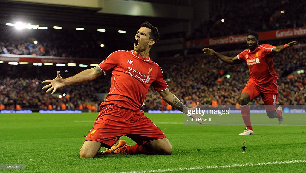 <a gi-track='captionPersonalityLinkClicked' href=/galleries/search?phrase=Dejan+Lovren&family=editorial&specificpeople=5577379 ng-click='$event.stopPropagation()'>Dejan Lovren</a> of Liverpool celebrates his winning goal during the Capital One Cup Fourth Round match between Liverpool and Swansea City at Anfield on October 28, 2014 in Liverpool, England.