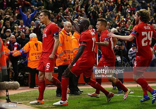 Dejan Lovren of Liverpool celebrates scoring his team's fourth goal with team mates during the UEFA Europa League quarter final second leg match...