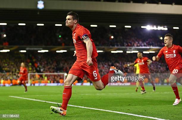 Dejan Lovren of Liverpool celebrates scoring his team's fourth goal during the UEFA Europa League quarter final second leg match between Liverpool...