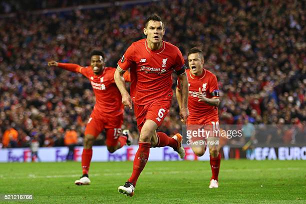 Dejan Lovren of Liverpool celebrates scoring his team's fourth goal during the UEFA Europa League quarter final second leg match between Liverpool...
