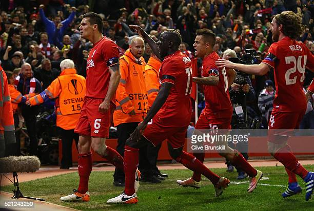 Dejan Lovren of Liverpool celebrates scoring his team's fourth goal with his team mates during the UEFA Europa League quarter final second leg match...
