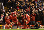 Dejan Lovren of Liverpool celebrates scoring the winning goal during the Capital One Cup Fourth Round match between Liverpool and Swansea City at...