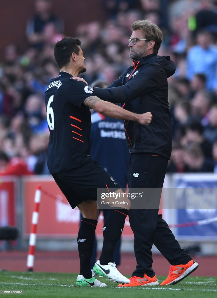 Dejan Lovren of Liverpool celebrates the Liverpool second goal with Jurgen Klopp, Manager of Liverpool during the Premier League match between Stoke City and Liverpool at Bet365 Stadium on April 8, 2017 in Stoke on Trent, England.