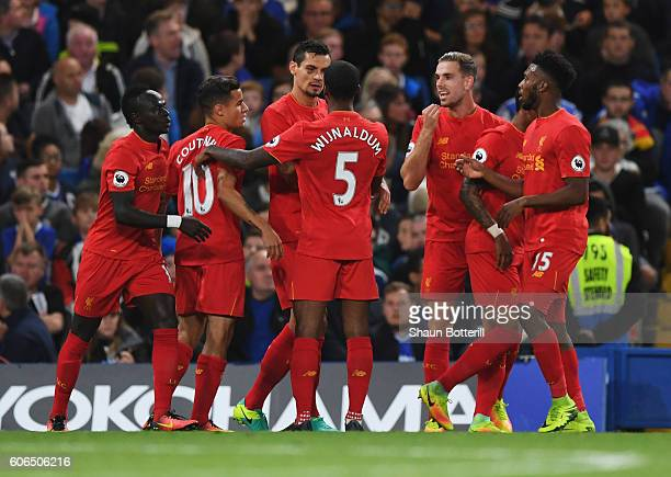 Dejan Lovren of Liverpool celebrates with team mats as he scores their first goal during the Premier League match between Chelsea and Liverpool at...