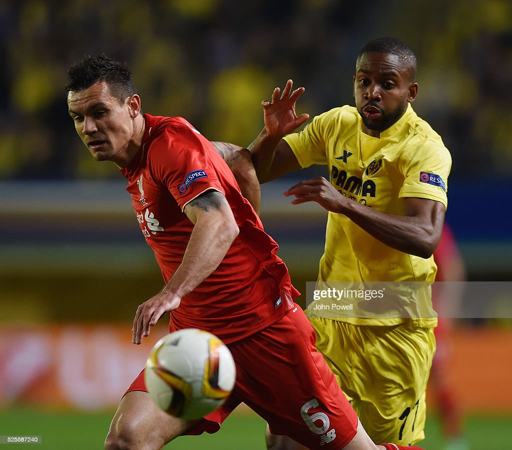 <a gi-track='captionPersonalityLinkClicked' href=/galleries/search?phrase=Dejan+Lovren&family=editorial&specificpeople=5577379 ng-click='$event.stopPropagation()'>Dejan Lovren</a> of Liverpool competes with <a gi-track='captionPersonalityLinkClicked' href=/galleries/search?phrase=Cedric+Bakambu&family=editorial&specificpeople=7119714 ng-click='$event.stopPropagation()'>Cedric Bakambu</a> of Villarreal during the UEFA Europa League Semi Final: First Leg match between Villarreal CF and Liverpool on April 28, 2016 in Villarreal, Spain.