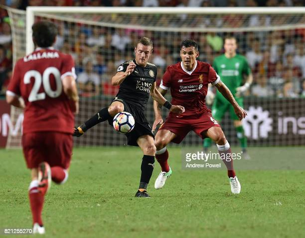 Dejan Lovren of Liverpool competes with Jamie Vardy of Leicester City during the Premier League Asia Trophy match between Liverpool FC and Leicester...