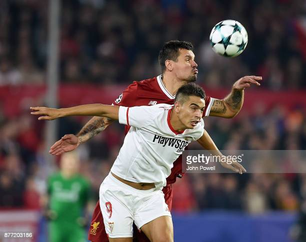 Dejan Lovren of Liverpool competes with Wissam Ben Yedder of Sevilla FC during the UEFA Champions League group E match between Sevilla FC and...