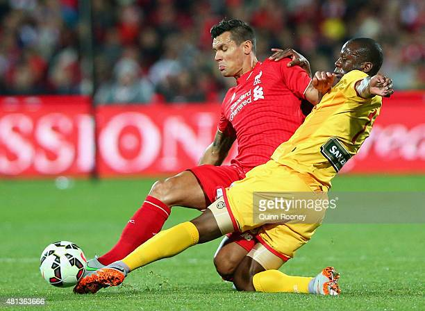 Dejan Lovren of Liverpool FC and Bruce Djite of United compete for the ball during the international friendly match between Adelaide United and...